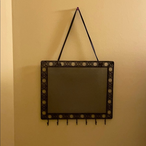Black metallic jewelry hanger